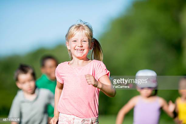 children running through the park - skipping along stock pictures, royalty-free photos & images