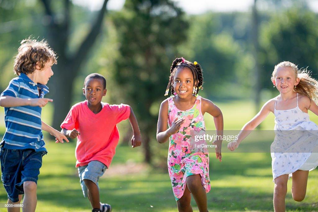 Children Running Through the Park : Stock Photo