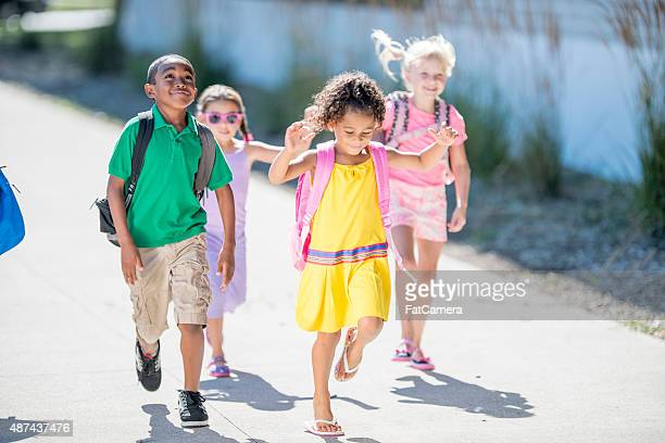 children running to class - skipping along stock pictures, royalty-free photos & images