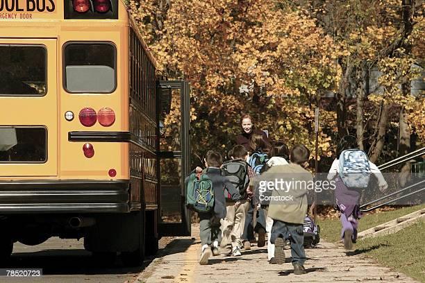 Children running to school bus