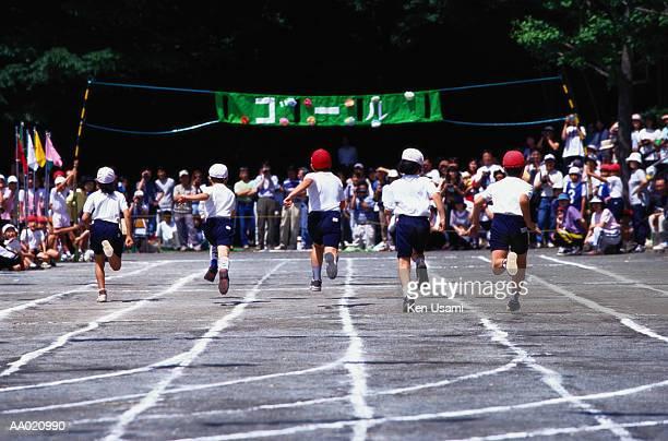 Children Running Toward the Finish Line