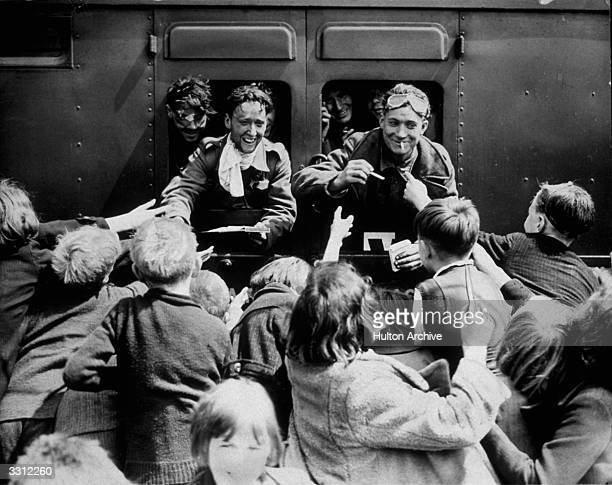 Children rush up to a train carrying BEF men back from Dunkirk