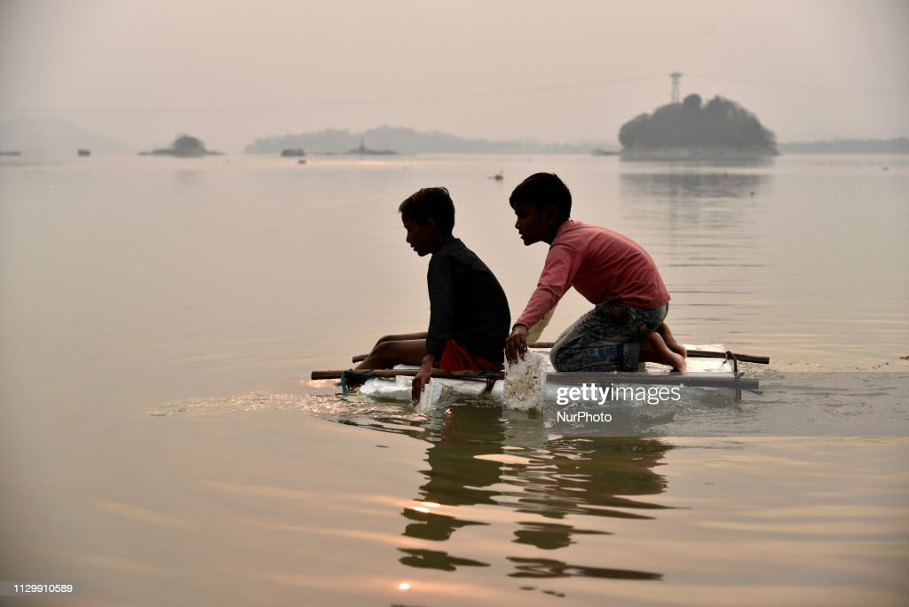Children sailing a boat made of Polystyrene foam sheets in the
