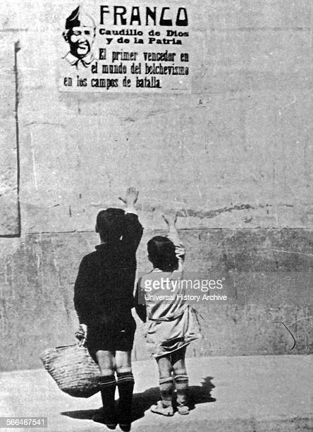 Children salute General Franco on a wall poster in Spain during the Spanish Civil War 1937