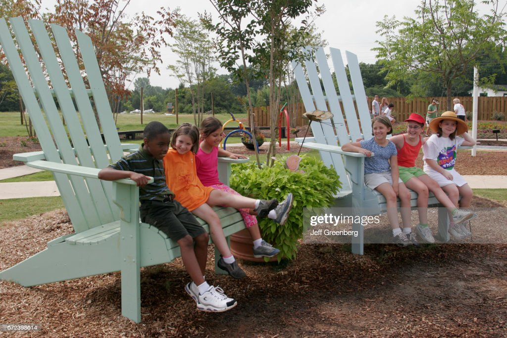 Children Sat On Giant Adirondack Chairs In The Childrenu0027s Outdoor Gardens  At The Botanical Gardens In