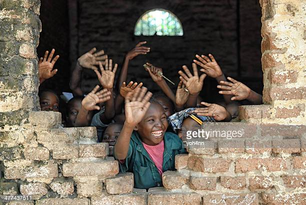 children say hello from african school - charity and relief work stock pictures, royalty-free photos & images