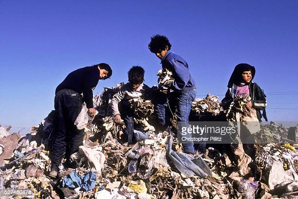 Children scavenging for food and any other useful things on a municipal rubbish dump in Buenos Aires city Argentina