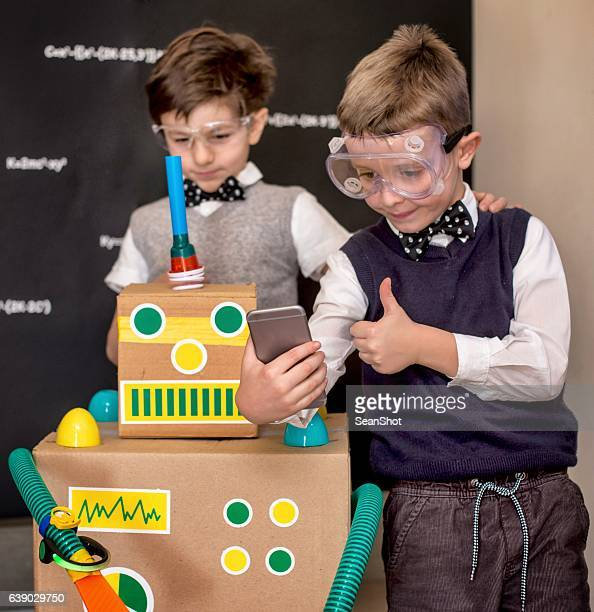 Children Scientists Doing a Selfie with their Toy Robot