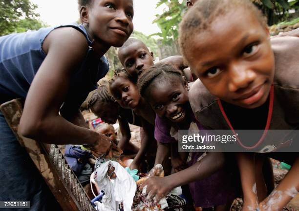 Children scrub their clothes in a river in Wilberforce on November 26 2006 in Freetown Sierra Leone Sierra Leone was ravaged by a decade long civil...