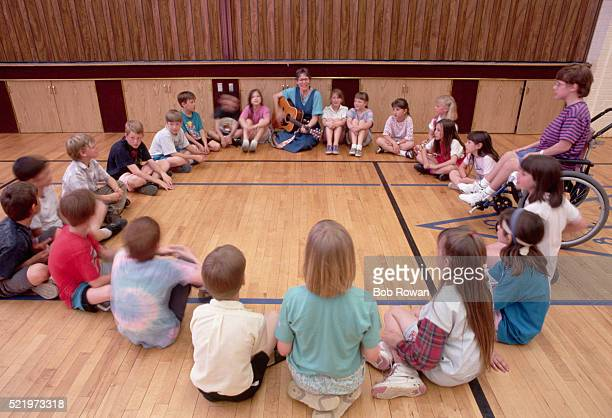 Children Seated in a Circle for Music Class