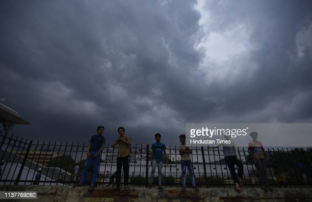 Children seen as clouds hover over Ramilia Ground on April 17 2019 in New Delhi India Strong winds accompanied by light rain lashed the Capital in...