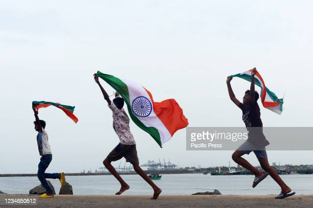 Children seen carrying Indian National Flag in a fishing area in Chennai. India celebrates its anniversary of Independence from British colonial rule...