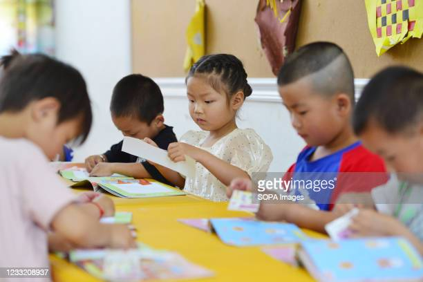 Children seen during their class activities at a central kindergarten of lvzhai Town. The Political Bureau of the Communist Party of China 's Central...