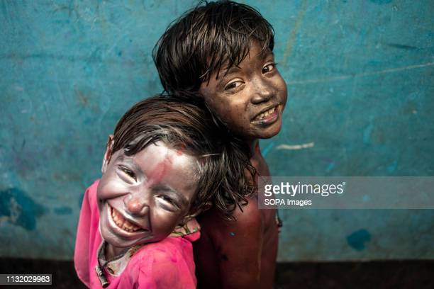 Children seen expressing their happiness with their faces painted during the Holli celebration Holi known as the festival of colour is an ancient...