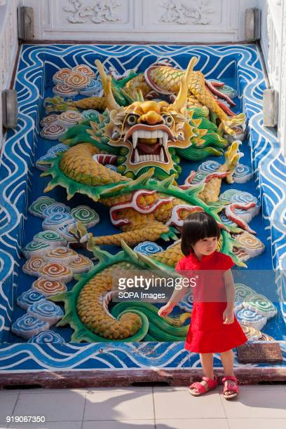 A children seen in front of the dragon statue during the day of Chinese New Year at Thean Hou temple Chinese New Year is the first day of the New...