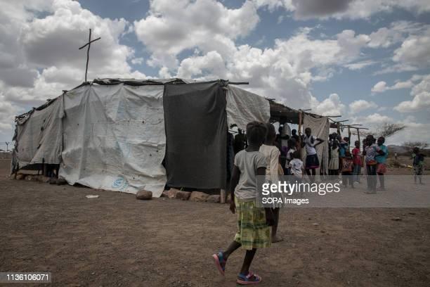 Children seen walking past a church in Kakuma refugee camp, northwest Kenya. Kakuma is home to members of the local Turkana community and the nearby...