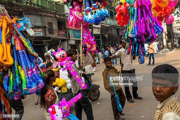 Children sell balloons after Eid alAdha prayers outside of the Jama Masjid on October 27 2012 in New Delhi India Eid alAdha also known as the Feast...
