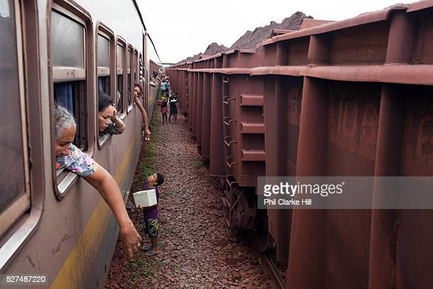Children selling food and drinks to passengers the Carajas railway is privately owned and operated by Vale it runs for 900km from Sao Luis Maranhao...