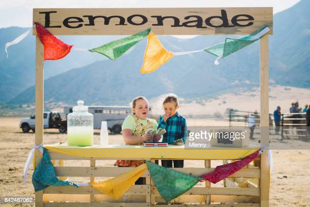 children selling homemade lemonade at rodeo stand - family dollar store stock pictures, royalty-free photos & images