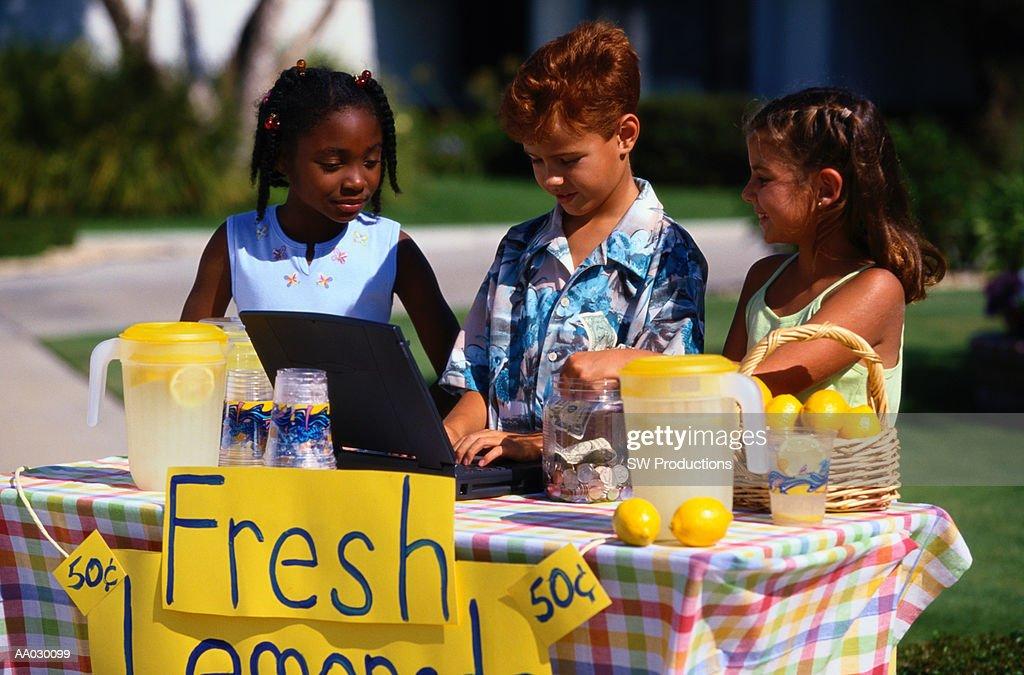 Children Selling Lemonade at Lemonade Stand : Stock Photo