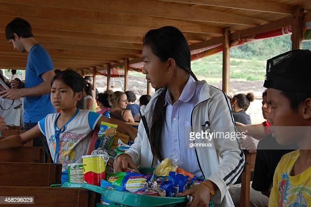 Children selling snacks, Mekong river boat - Laos