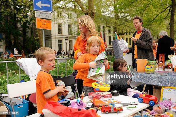 children selling toys on queen's day in utrecht - king's day netherlands stock pictures, royalty-free photos & images