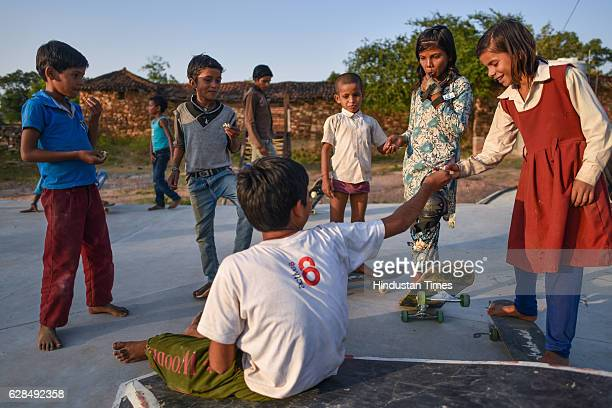 Children sharing a fruit at Skating Park, popularly known as Janwaar Castle, on October 26, 2016 in Janwaar, India. Thanks to a German community...
