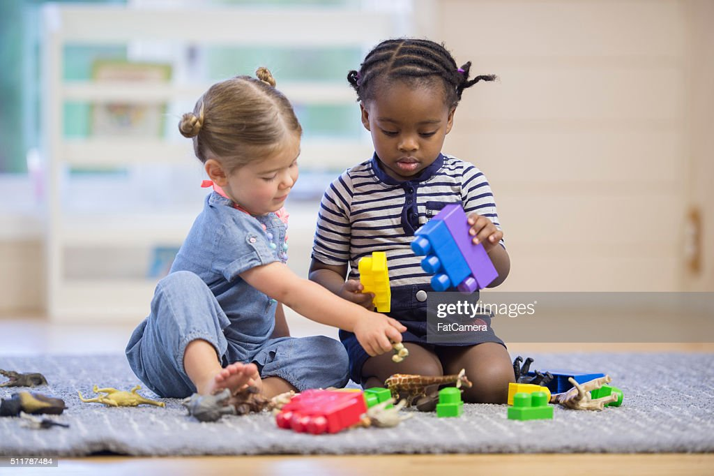 Boys Sharing Toys : Children sharing toys stock photo getty images