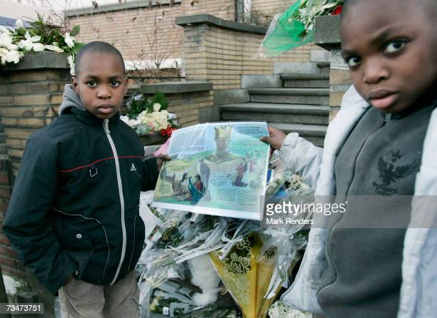 Children show a drawing they made at the entrance of the house of the Mokadem family at the General Jaques Avenue March 2 2007 in Nivelles Belgium...