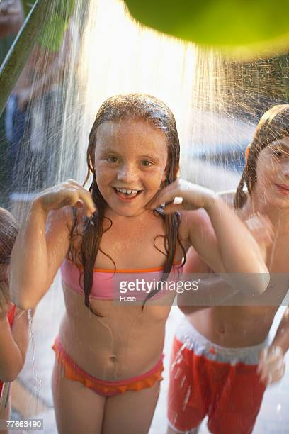 Children Showering Outdoors