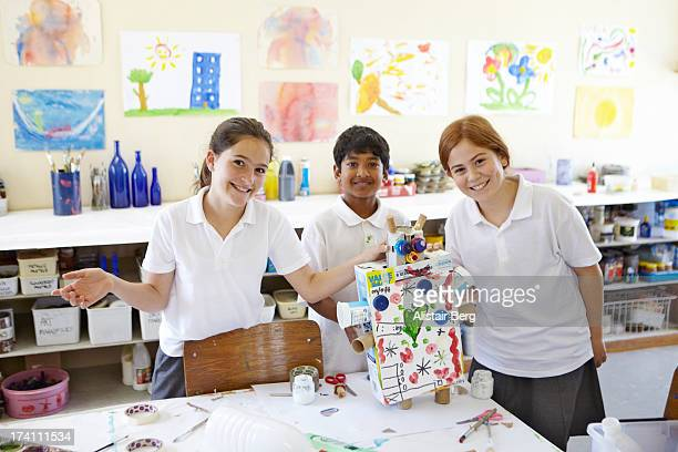 Children showing off their work at school