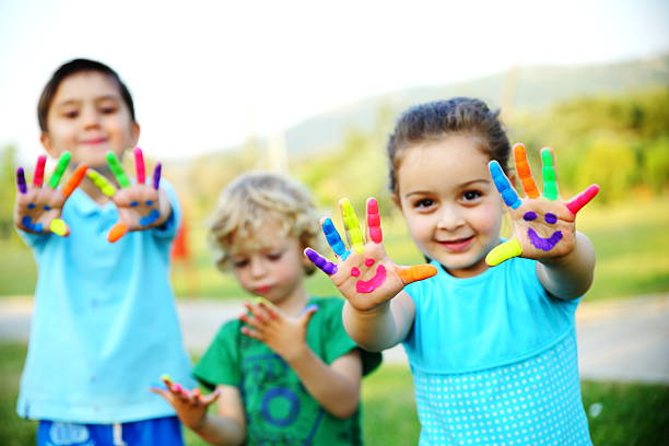 children showing their painted hands - Free Images Of Kids