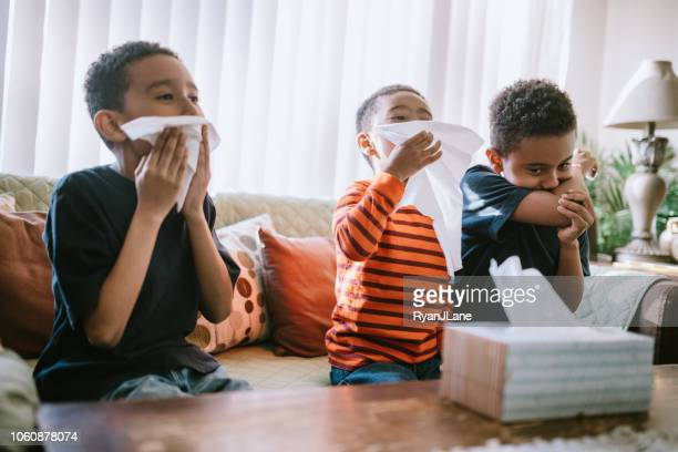 children sick with cold cough and sneeze at home - pneumonia stock pictures, royalty-free photos & images