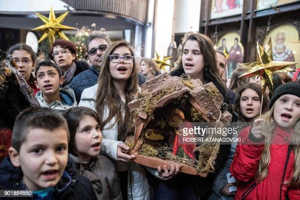Children sing church songs on Christmas Eve during a religious service to celebrate the Orthodox Christmas at St Clement Cathedral in Skopje on...