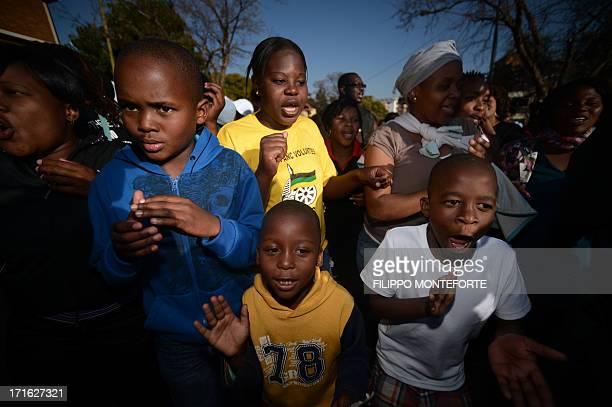 Children sing for former South African President Nelson Mandela at the Medi Clinic Heart hospital in Pretoria on June 27, 2013. Nelson Mandela...