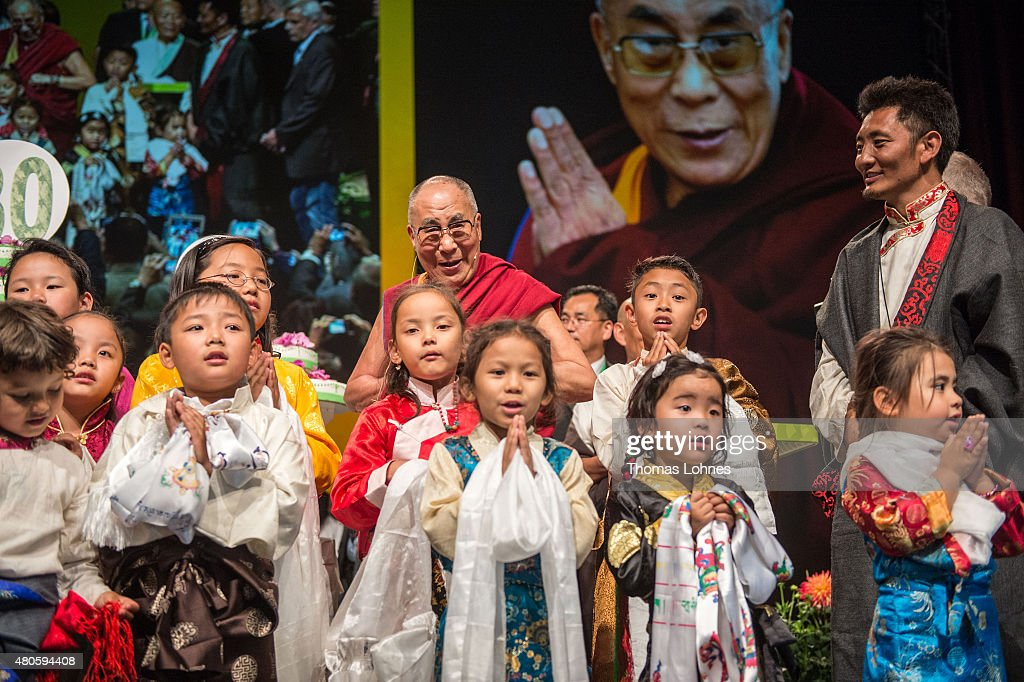 Children sing Happy Birthday to The XIV Dalai Lama during his 80th birthday celebrations at the 'Jahrhunderthalle' on July 13, 2015 in Frankfurt, Germany.