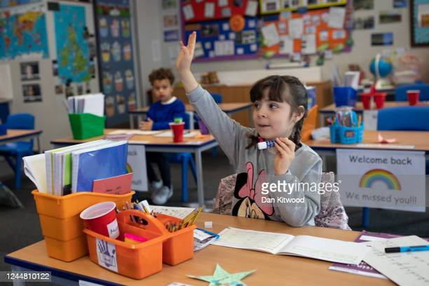 Children sit at individual desks during a lesson at the Harris Academy's Shortland's school on June 04, 2020 in London, England. As part of Covid-19...