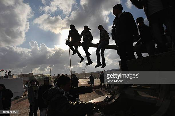 Children sit atop a tank during a celebration of the 'liberation' of eastern Libya on February 26, 2011 in Benghazi, Libya. Citizens continue to...