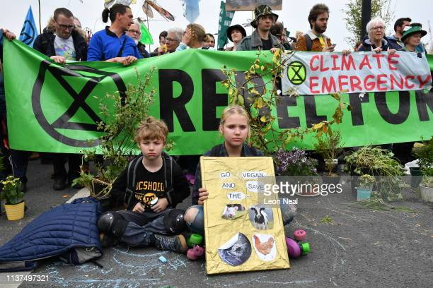 Children sit down at a blockade on Waterloo Bridge during the second day of a coordinated protest by the Extinction Rebellion group on April 16 2019...