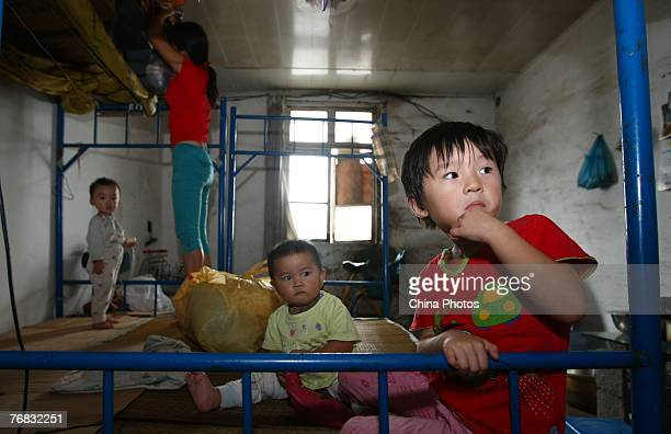 Children sit in a disaster shelter waiting for Typhoon Wipha to make its landfall on September 18 2007 in Yueqing of Zhejiang Province China More...