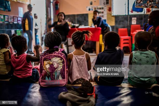 Children sit in class at the Childrens Orientation Centre in Klipspruit West in Soweto on March 13 2017 Nine children under the age of five years...