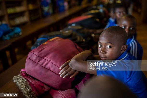 Children sit in school class room during FIFA Foundation Community Program visit on March 17, 2019 in Yaounde, Cameroon.