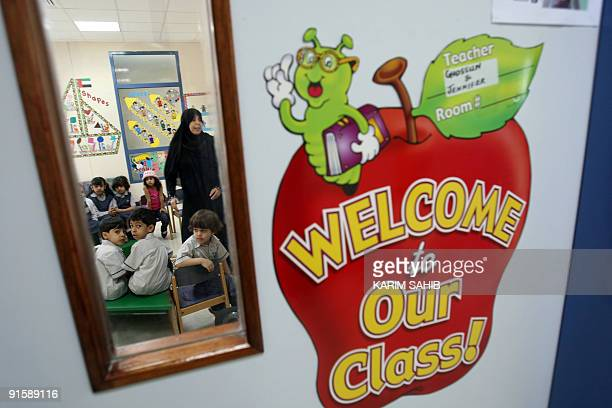 Children sit in their classroom on the first day of the public schools academic year in Dubai on September 27 2009 Many students were still absent as...