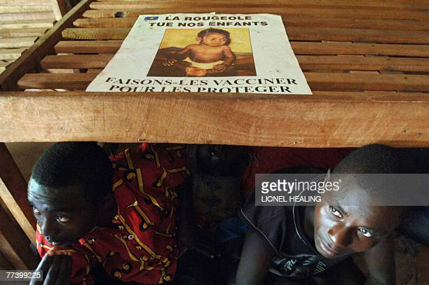 Children sit on a bed in an orphanage 18 October 2007 in Rutshuru Eastern Democratic Republic of Congo These children fled their school when fellow...