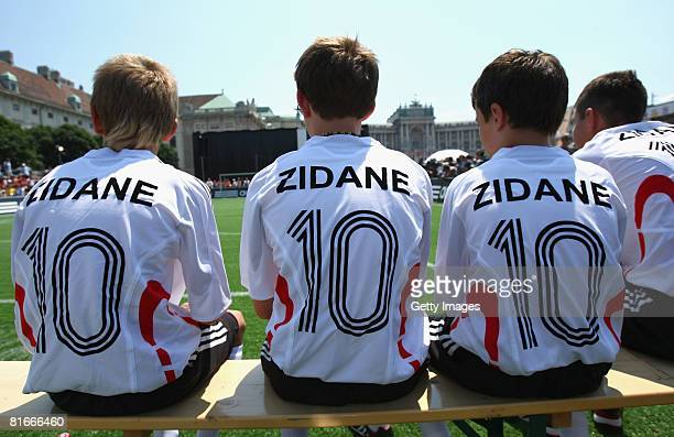 Children sit on a bench prior a match with former international footballer Zinedine Zidane at the Fan Park UEFA EURO 2008 on June 22, 2008 in Vienna,...