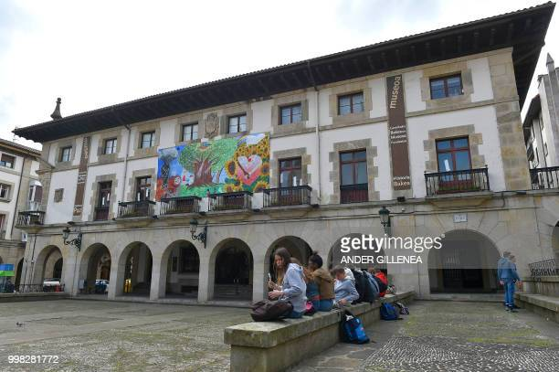 Children sit outside the Peace Museum in the Spanish Basque village of Guernica on May 4 2018 In Spain the issue of remembrance is especially...