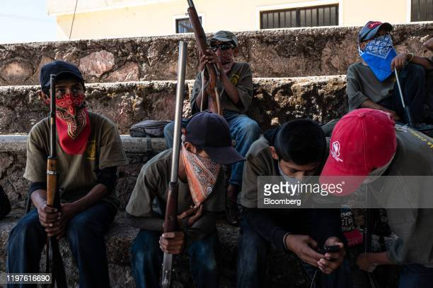 Children sit with rifles and mock rifles during a Regional Coordinator of Community Authorities community police force gun training presentation held...