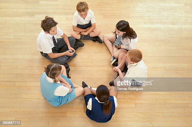 Children sitting in a circle