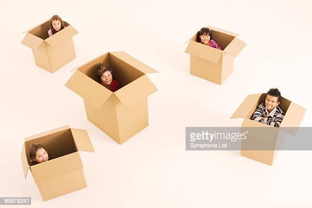 children sitting in boxes