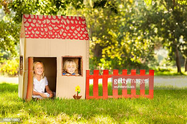 Children Sitting In Playhouse